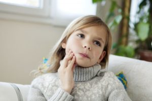 little girl with mouth pain