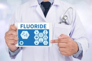 doctor pointing to fluoride on tablet
