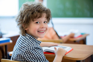 Little boy smiling in classroom
